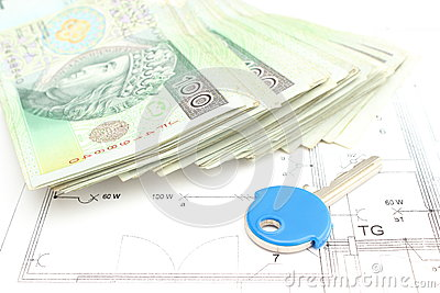 Money with key lying on the housing plan