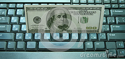 Money on a keyboard