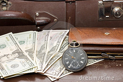 Money on an old suitcase