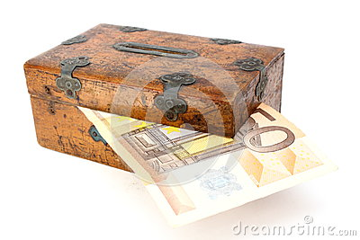 Money partly in wooden box