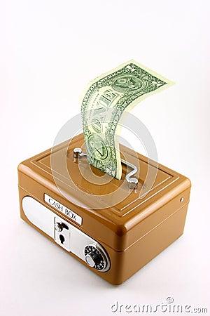 Dollar bill in cash box