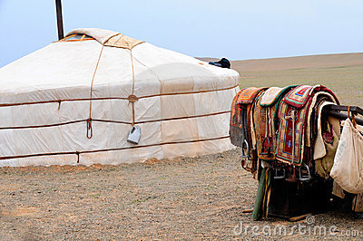 Mongolia – nomad gers (yurt) with horse saddles