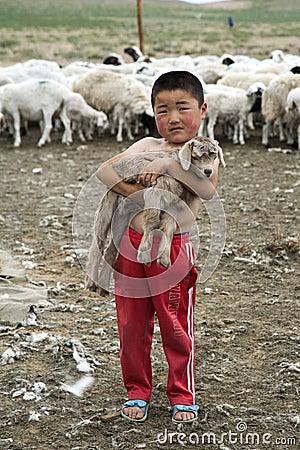 Mongolian Boy holding Baby Goat Editorial Image