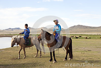 Mongolian Boys on Horseback Editorial Photography