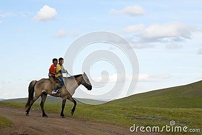Mongolian Boys Riding Horse Editorial Stock Image