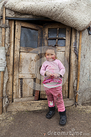 Mongolian child infront of Ger doors Editorial Stock Image