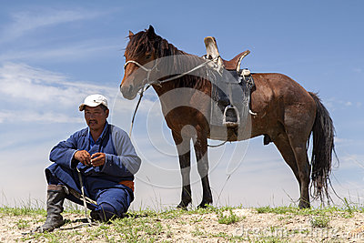 Mongolian Man and Horse Editorial Stock Photo