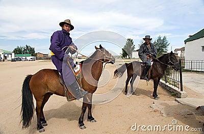 Mongolian Men on Horseback Editorial Stock Image