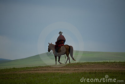 Mongolian Nomad on horse sky