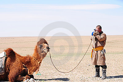 Mongolian nomadic herdsman with his camel Editorial Stock Photo