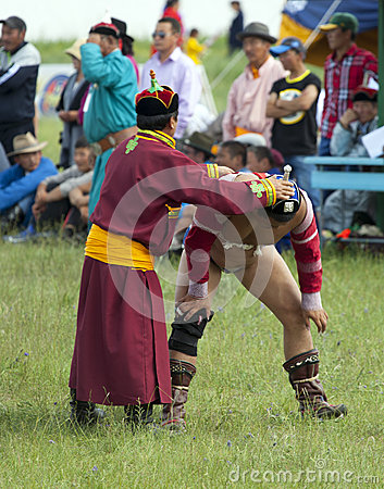 Mongolian Wrestler and Trainer Editorial Stock Image
