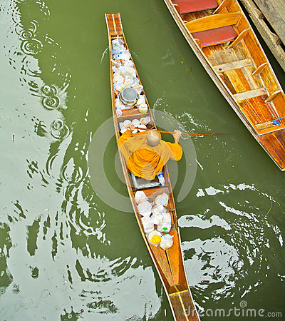 Monk on a boat at floating market, Thailand