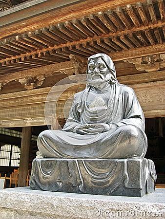 Monk buddhist statue