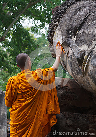 Monk is cleaning Buddha statue Editorial Photography