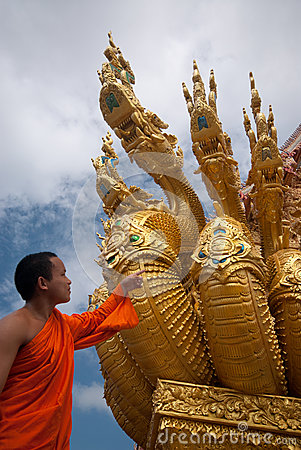 Monk looking serpent art . Editorial Stock Photo