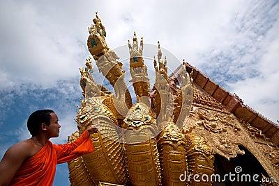 Monk looking serpent art . Editorial Photography