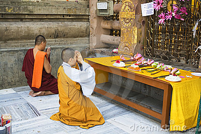 Monk and Nun at the Bodhi Tree, Bodhgaya Editorial Photo