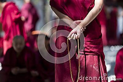 Monk with prayer beads