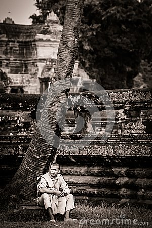 Monk stands on moat wall at Angkor Wat Temple Editorial Photography