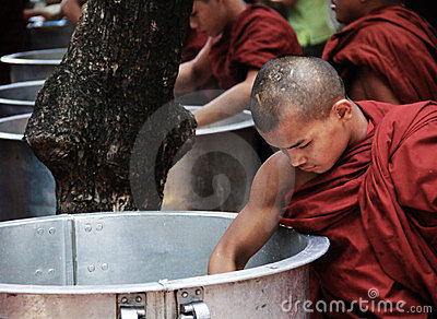 Monk taking rice from a big pan, myanmar Editorial Stock Image