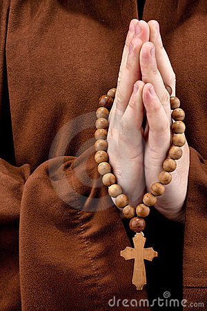 Monk with two hands clasped in prayer