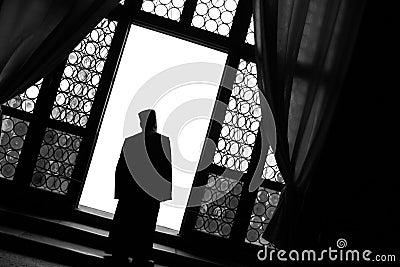 Monk at Window