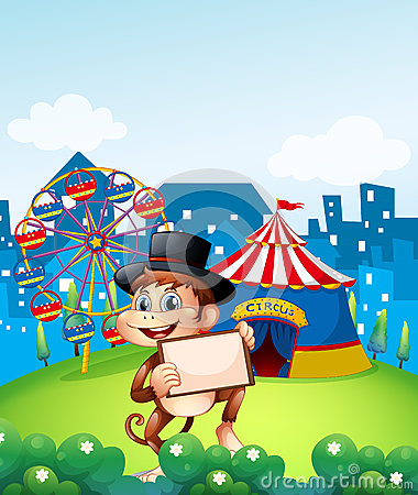 A monkey holding a frame in front of the carnival