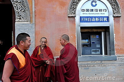 Monks and ATM Editorial Photo