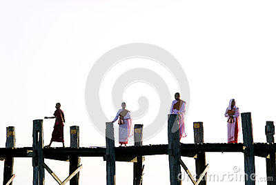 Monks crossing the u bein bridge, amarapura, myanmar Editorial Photo