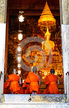 Monks pray in the evening in Wat Pho Temple. Editorial Photo