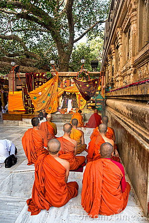 Monks praying under the bodhy-tree, Bodhgaya, Indi Editorial Stock Photo