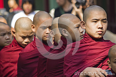 Monks in a row Editorial Photo