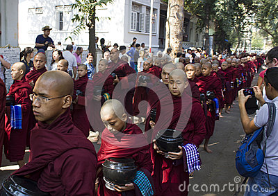 Monks in a row for lunch: Mahagandayon Monastery Editorial Photo