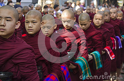 Monks in a row waiting for lunch: Mahagandayon Mon Editorial Stock Photo