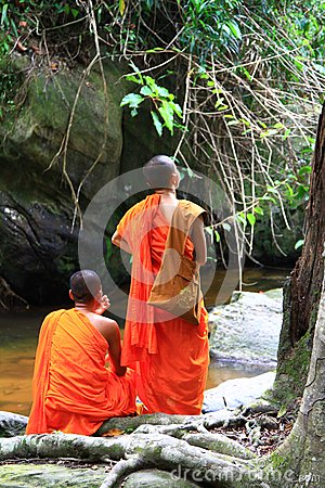 Free Monks Sitting Near Stream/waterfalls In The Jungle Royalty Free Stock Photo - 26636615