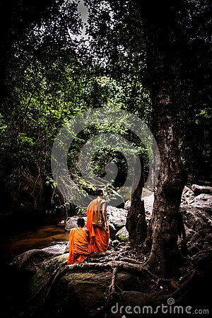 Free Monks Sitting Near Stream/waterfalls In The Jungle Royalty Free Stock Image - 26636616