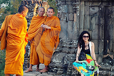Monks and traveler in Cambodia Editorial Image