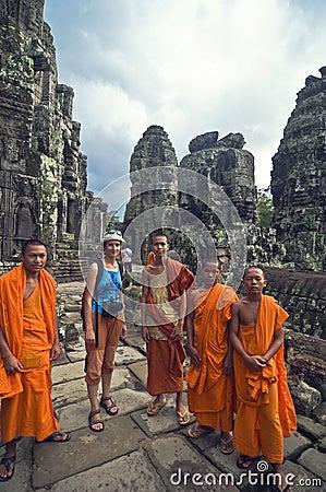 Monks and turist girl at  Angkor Wat Editorial Photography