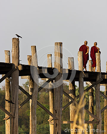 Monks walking on U Bein Bridge in Myanmar Editorial Stock Photo