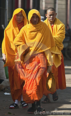 Monks in Yellow Editorial Stock Image
