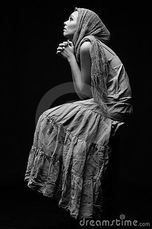 Monochrome portrait of praying woman