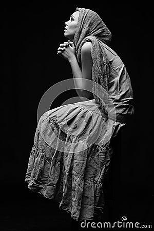 Monochrome portrait of praying woman