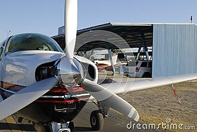 Monomotor airplane on hangar