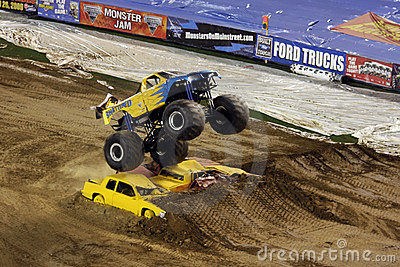 Monster truck jumps over cars Editorial Photo