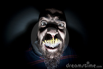 Monstrous man with long teeth