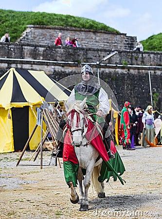 Knight Riding Horse Editorial Photo