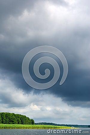 Moody sky over lake.