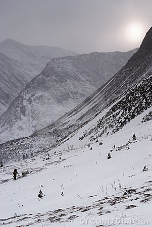 Moody weather in winter mountain landscape