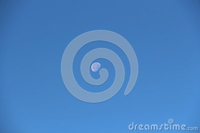 View of the old moon in the daytime sky Stock Photo