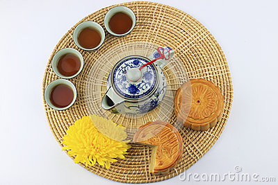 Moon cakes and tea on wicker tray